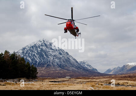 Glencoe, UK. 31st March 2013. Mountain rescue teams from Scotland resume their search for the missing skier on Glencoe - Stock Photo