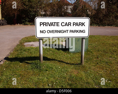 Private car park, no overnight parking, sign beside the car park of Cheddar Tyre service. march 2013 - Stock Photo