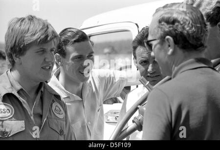 Jim Clark World Chamionpion formula 1 & Lotus Team Boss Colin Chapman  photographed in 1964 at Mosport Raceway,Ontario,Canada - Stock Photo