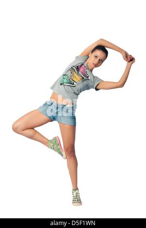 Funny girl waving his arms and legs doing gymnastics - Stock Photo