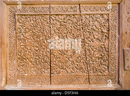 historical carved wooden door background in Jodhpur, India - Stock Photo