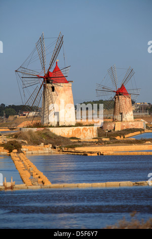 Windmills at Salt Pans in Trapani, Sicily, Italy - Stock Photo