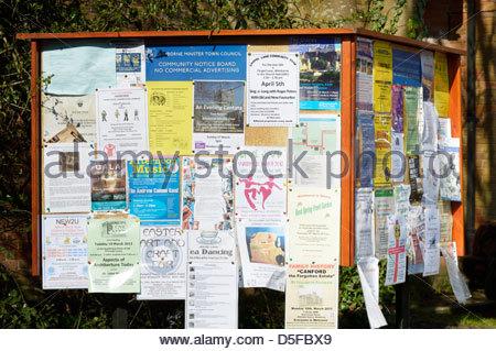 Community Notice Board, Wimborne Minster, Dorset, England - Stock Photo
