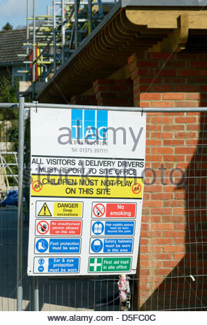TAG construction sign on fencing at a building site, Wimborne Minster, Dorset, England - Stock Photo