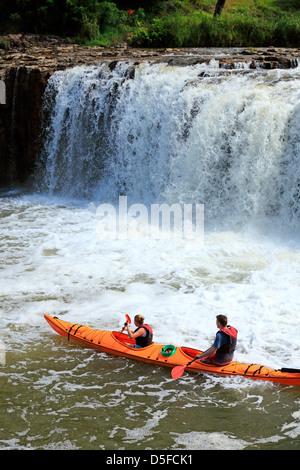 Kayaking at Haruru Falls on the Waitangi River in Northland. - Stock Photo
