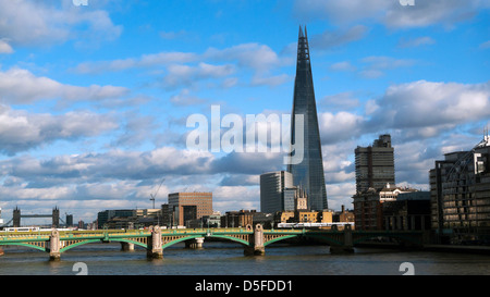Cityscape view of the Shard building, Southwark Bridge and Tower Bridge on the River Thames in Central London England - Stock Photo