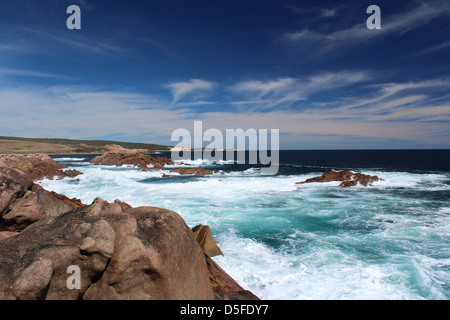 The Indian ocean washes over the rocky outcrops  at Canal rocks western Australia and rushes up the foaming rocky - Stock Photo