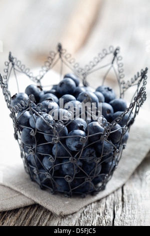 Fresh blueberries on wooden table, selective focus - Stock Photo