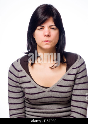 Angry young woman sulking - Stock Photo