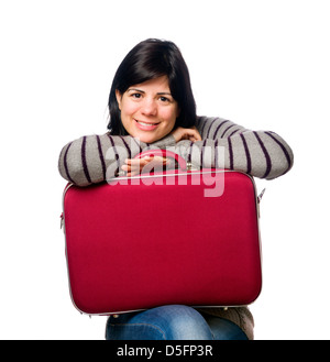 Portrait of pretty young woman holding a red suitcase isolated on white background - Stock Photo