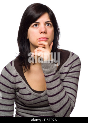 Portrait of pensive young woman with hand on chin isolated on white background - Stock Photo