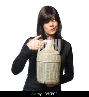 Drunk woman smiling while holding wine carboy and making a funny face isolated on white background - Stock Photo
