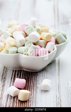 Colorful marshmallows in white bowl, selective focus - Stock Photo