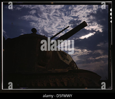 The crew of an M-3 tank learn all the ways of causing trouble for the Axis with a 75-mm. gun, a 37-mm. gun and four - Stock Photo