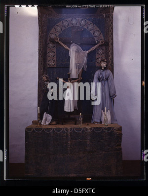 Altar in the church, Trampas, New Mexico. The prevailing colors are grey and blue. A Coca-Cola bottle is used as - Stock Photo