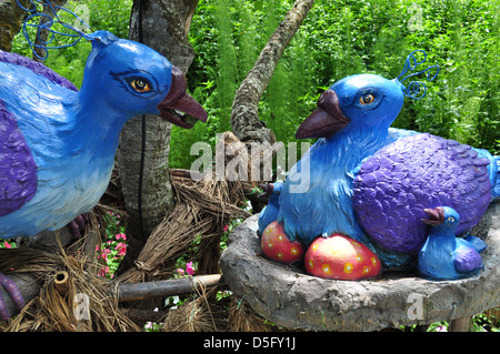 Peacock wooden birds, with chicks and eggs at Imbiah Lookout, Sentosa Island - Stock Photo
