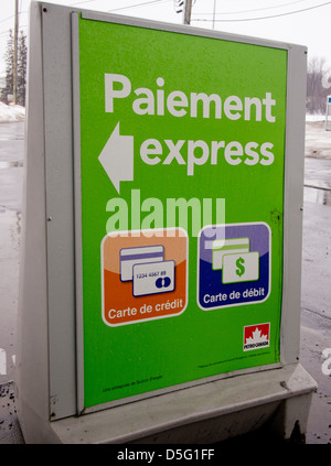 French sign in Quebec at Gas station - Stock Photo