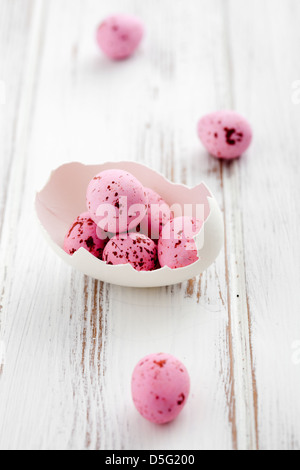 Broken egg shell with pink easter eggs - Stock Photo