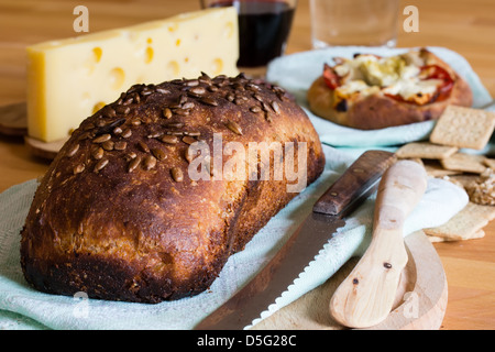 Composition with crusty bread, yellow cheese and red wine - Stock Photo