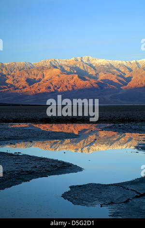 Telescope Peak (11,049 ft.) and Panamint Range reflected on pond, Badwater Basin, Death Valley National Park, California - Stock Photo