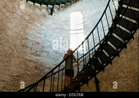 Boy marvels at the interior of a lighthouse, Corolla Lighthouse, Outer Banks, NC, North Carolina - Stock Photo