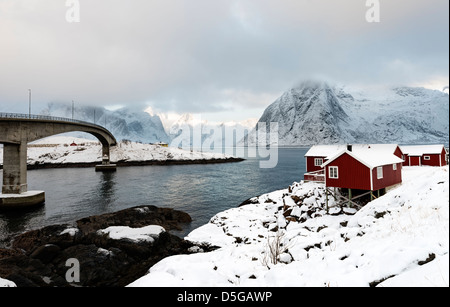 A view Reinefjorden towards the mountain of Olstind from the road at Hamnoy harbour - Stock Photo
