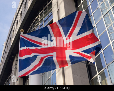 British flag in front of the European Parliament building in Brussels, Belgium - Stock Photo