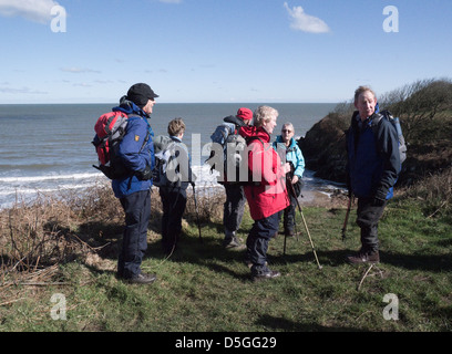 North Wales Walkers on the Isle of Anglesey Coastal Path suitabiliy dressed for a walk along Ynys Mon coast on a - Stock Photo