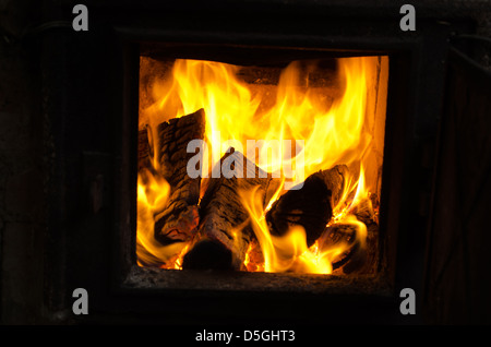 firewood wood burn retro old rusty rural kitchen brick stove. - Stock Photo