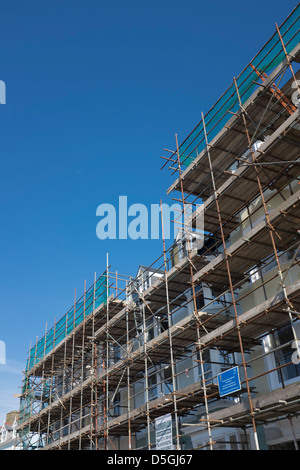 Houses covered in scaffolding, being renovated as part of an urban renewal scheme, Aberystwyth Wales UK - Stock Photo