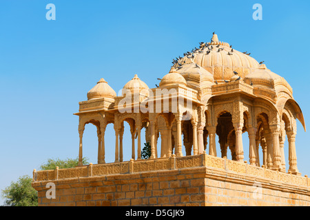 Chhatris on ruins of the royal cenotaphs of ancient Maharajas rulers in Bada Bagh, India - Stock Photo