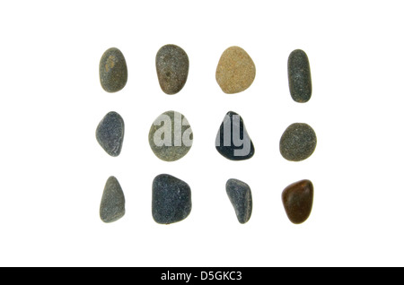 Twelve smooth, rounded beach stones of Maine granite, jasper, and schist. - Stock Photo