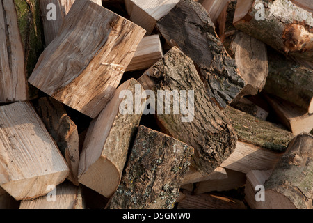 A pile of fire wood logs ready to be burnt, just been delivered and split. - Stock Photo