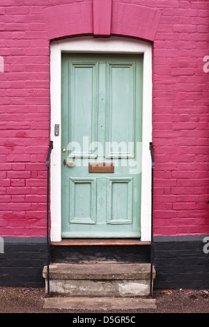 Green wooden front door of an english house - Stock Photo