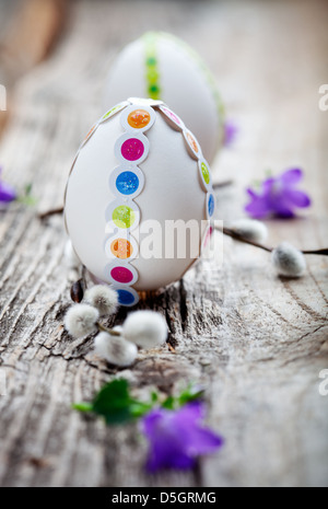 White easter eggs decorated with colorful stickers - Stock Photo