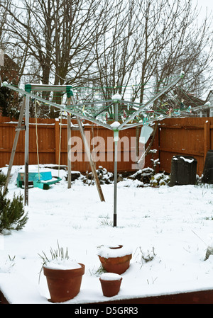 Snow falling in a home garden in the UK - Stock Photo