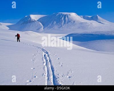 Single skier ski touring in northern Norway on the Troms Border Trail, near Tromso - Stock Photo