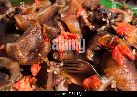 Madagascar, Ambositra, Marche Sandrandahy market, food stall, cooked pork skin snack - Stock Photo