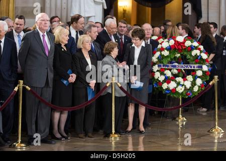 Senator Patrick Leahy, left, (D-VT) waits for the arrival of the casket of Senator Daniel Inouye (D-HI) in the U.S. - Stock Photo