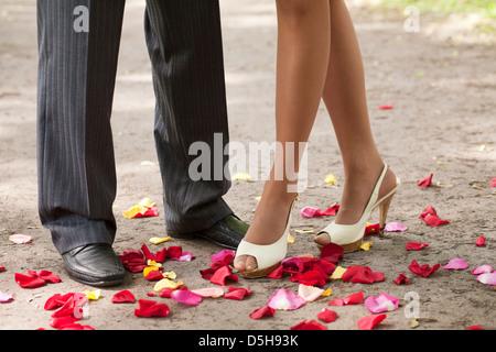 legs over petals - Stock Photo