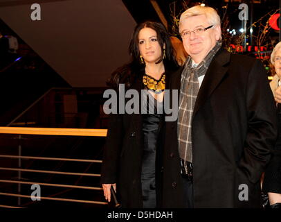 Former German foreign minister Joschka Fischer and his wife, producer Minu Barati, arrive for the premiere of the - Stock Photo