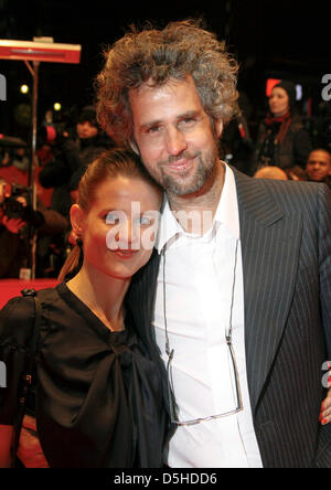 German director Christoph Schlingensief (R) and his partner Aino Laberenz (L) arrive at the opening of the 60th - Stock Photo