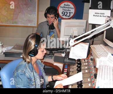(dpa file) A file picture dated 15 February 2009 of radio host Daniella and her assistant delivering the traffic - Stock Photo