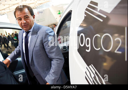 Galician Minister of Economics Javier Guerra alights from a Citroen Berlingo Electrique ,which is produced in Spain, - Stock Photo