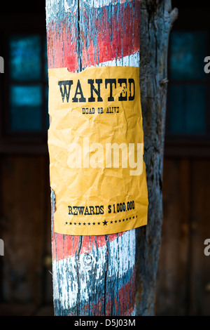 vintage wanted poster in a gost town - Stock Photo