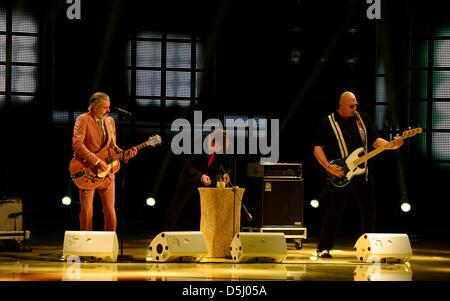 Belgian band Triggerfinger performs during the Golden Hen (Goldene Henne) media prize awards ceremony in Berlin, - Stock Photo