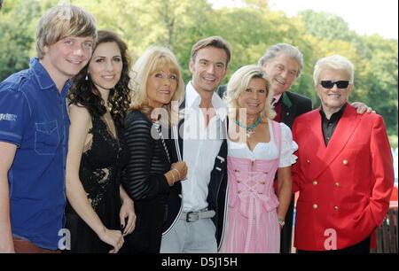 Tobias Thomann (L-R) from the band Dorfrocker, as well as singers Maria Levin, Lena Valaitis, Florian Silbereisen, - Stock Photo