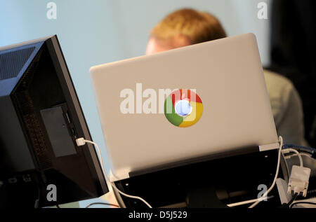 A Google employee works at his desk in the Berlin office of the company in Germany, 13 November 2012. The office - Stock Photo