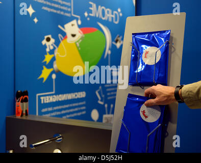 Drawings of Google products, such as the web browser Chrome, are pictured on a wall in the bathroom of Google's - Stock Photo