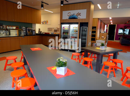 Red chairs are pictured in the cafeteria of Google's Berlin office in Germany, 13 November 2012. The office opened - Stock Photo